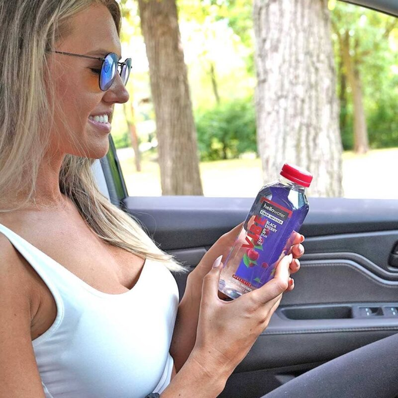 girl holding hellowater® Prebiotic fiber infused flavored water - vibe- black cherry 1080x