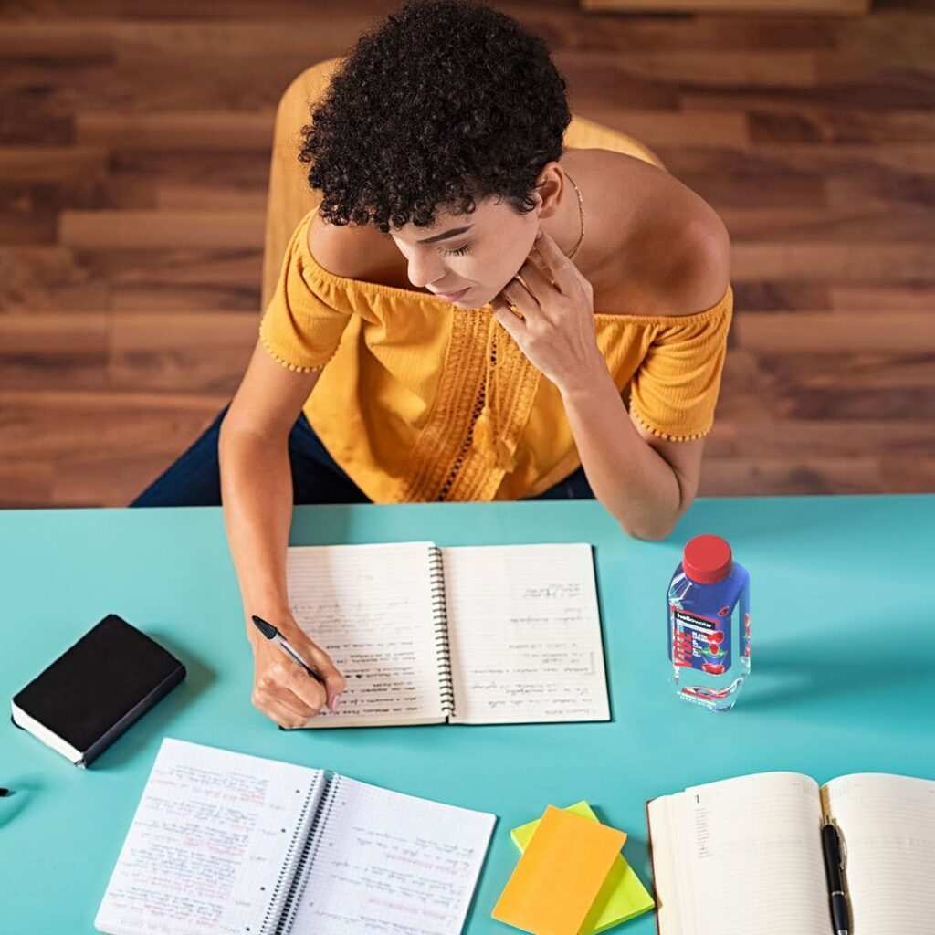 college-student-copying-notes-drinking - hellowater® Prebiotic
