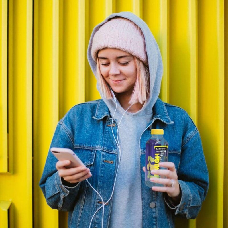 girl drinking hellowater® Prebiotic fiber infused flavored water - laugh - lemon lime1080x