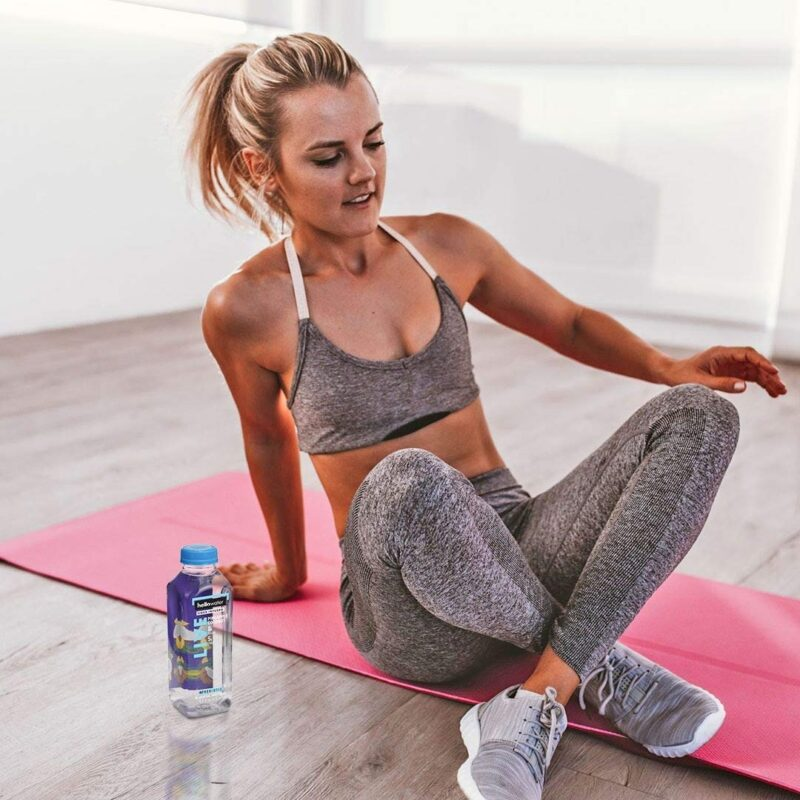 girl doing yoga - drinking hellowater® Prebiotic fiber infused flavored water - live- pineapple coconut 1080x